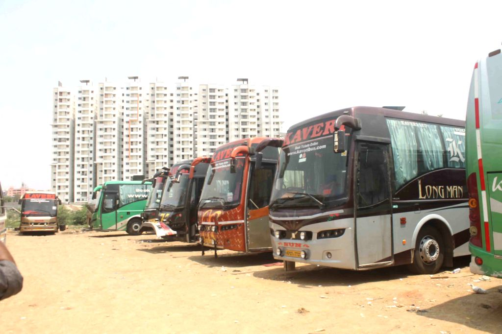 Buses plying on Hyderabad -Vijayawada remain parked in their depot to protest against toll levied on buses entering Telangana, in Hyderabad, on April 1, 2015.