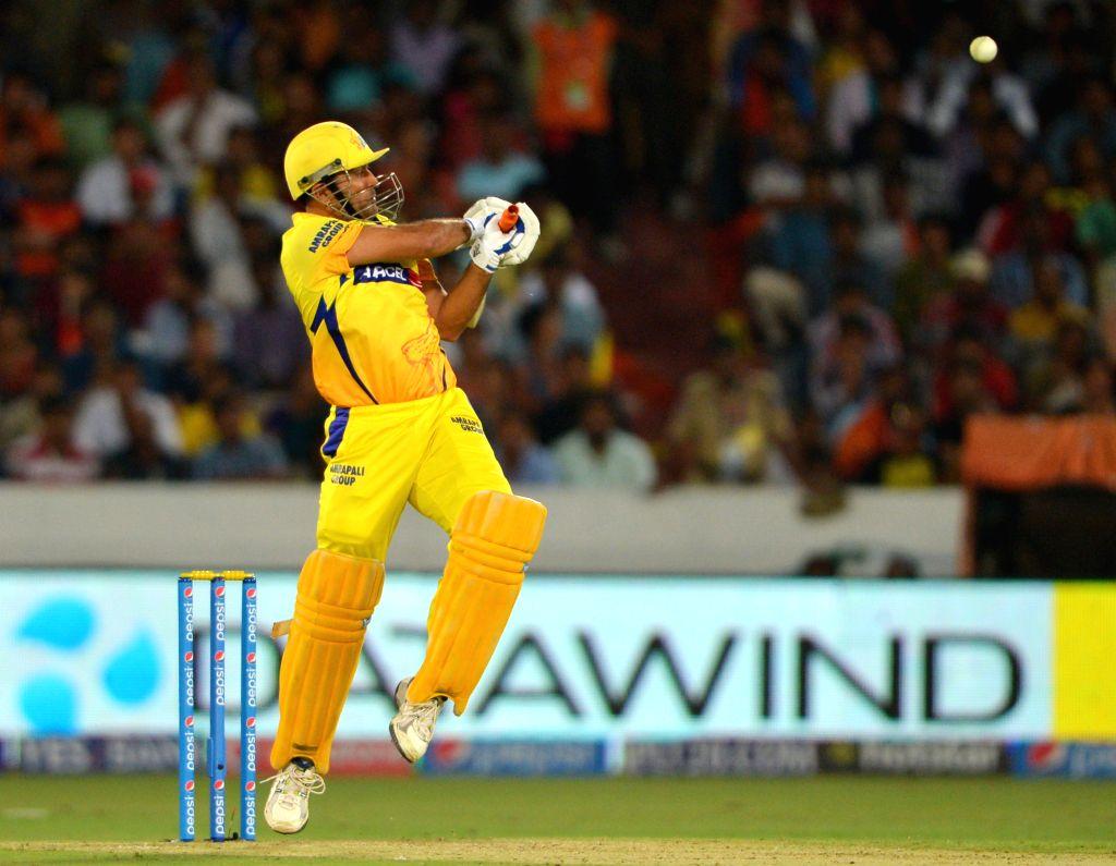 Chennai Super Kings batsman MS Dhoni in action during an IPL-2015 match between Chennai Super Kings and Sunrisers Hyderabad at Rajiv Gandhi International Stadium, Uppal in Hyderabad on May ... - MS Dhoni
