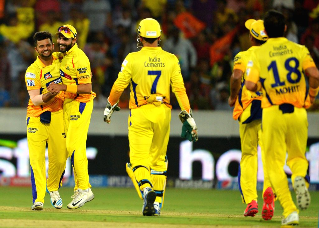 Chennai Super Kings players celebrate fall of a wicket during an IPL-2015 match between Chennai Super Kings and Sunrisers Hyderabad at Rajiv Gandhi International Stadium, Uppal in ...