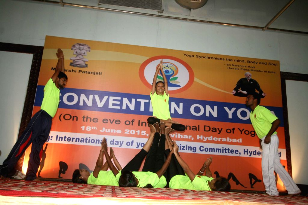 Children participate during a yoga session in Hyderabad on June 18, 2015.