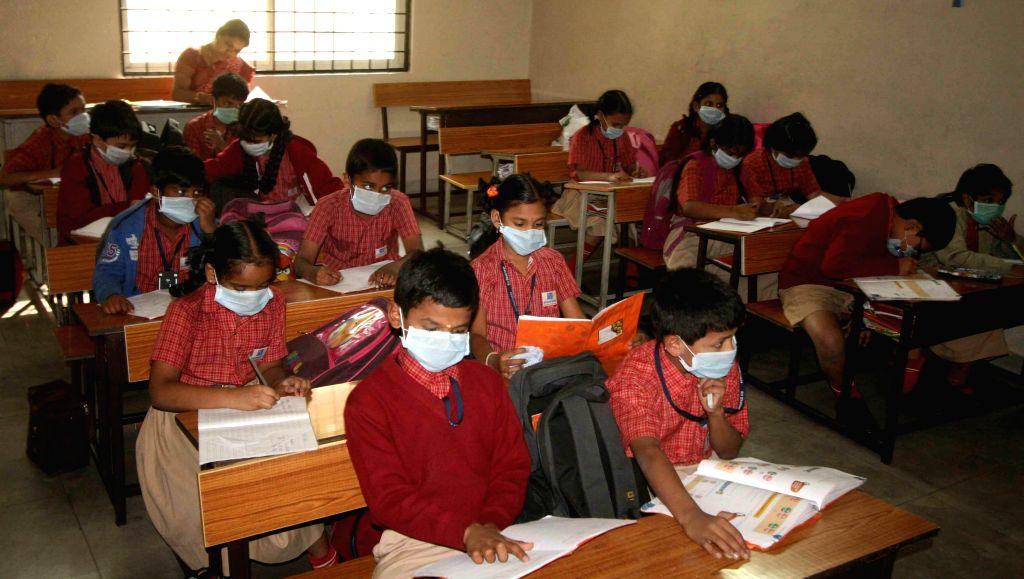 Children wear protective masks to avoid contracting swine flu in Hyderabad, on Jan 22, 2015.