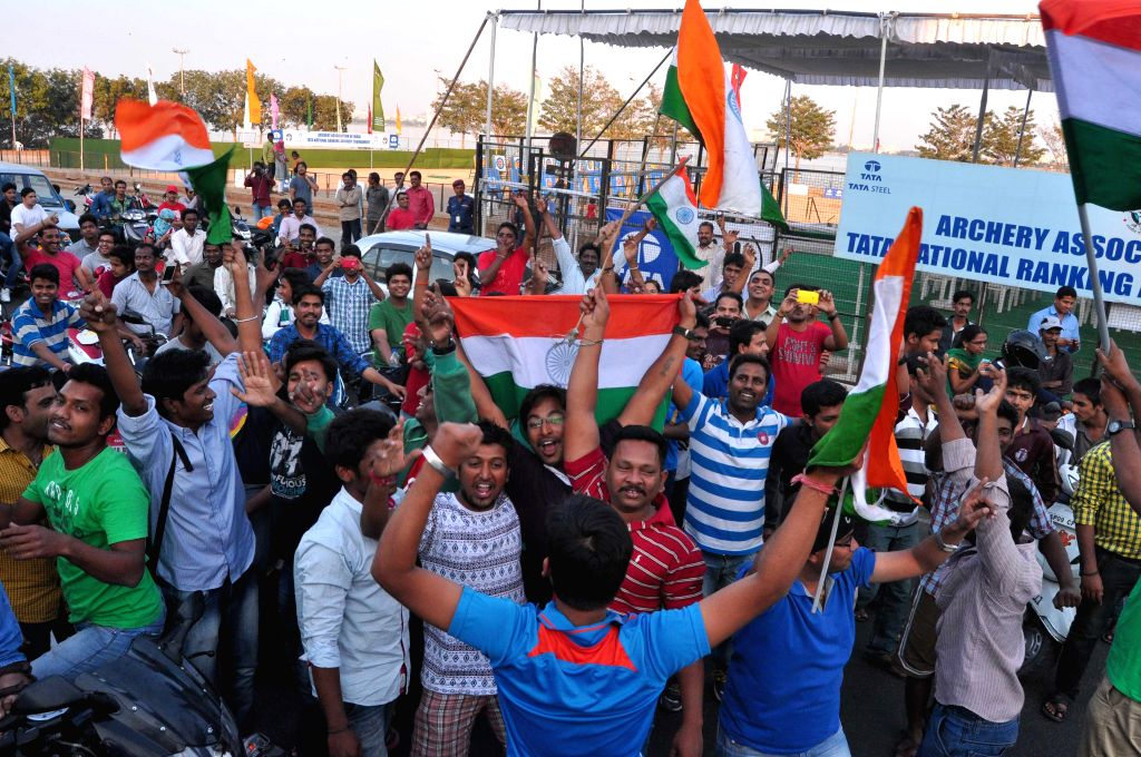 Cricket fans celebrate India's victory over Pakistan in an ICC World Cup 2015 match, in Hyderabad, on Feb 15, 2015.