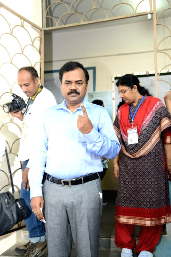 Hyderabad District Election Officer (DEO) and GHMC Commissioner Dana Kishore shows his inked finger after casting his vote for the 2019 Lok sabha elections in Hyderabad, on April 11, 2019. (Photo: IANS)