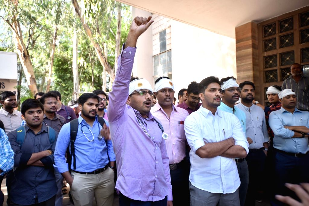 Hyderabad: Doctors of National Institute of Management Solutions (NIMS) wear bandages on their heads as they stage a demonstration against doctors who were assaulted in Kolkata and press for adequate protection for their counterparts, in Hyderabad on
