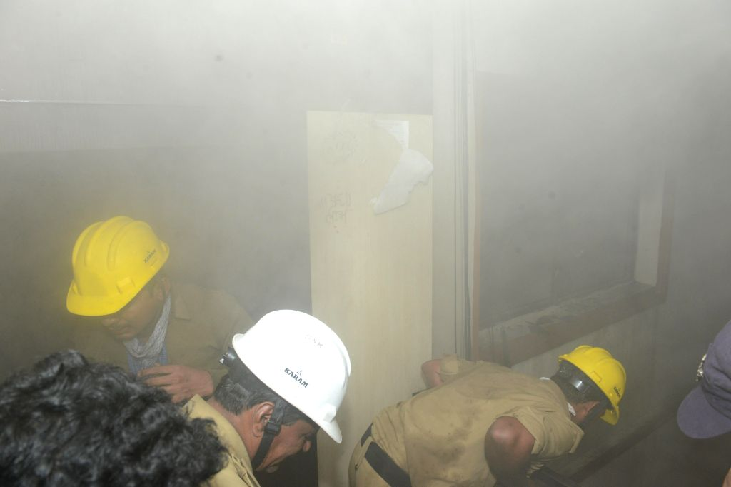 Firefighters try hard to douse a fire that broke out at at Panjagutta in Hyderabad, on Dec 27, 2014.