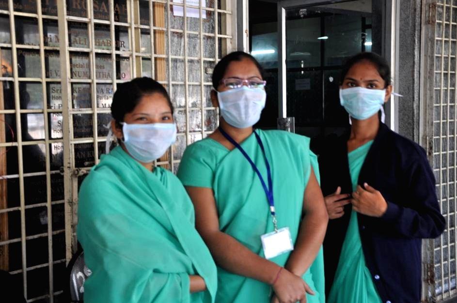 Gandhi Hospital staff wear masks to avoid contracting swine flu in Hyderabad, on Jan 20, 2015.