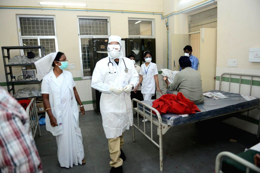 Gandhi Hospital staff wear masks to avoid contracting swine flu in Hyderabad, on Jan 21, 2015.