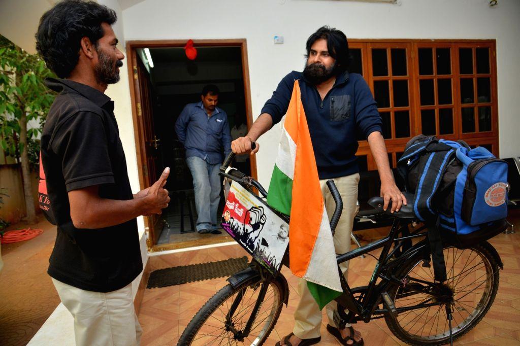Hero Pavan Kalyans fan Addamki Ravi from Kharagpur of West Benagal traveled by bicycle to meet his hero on 3rd April, 2015 .  He reached Hyderabad on 30 April, 2015 and met Pavan Kalyan.