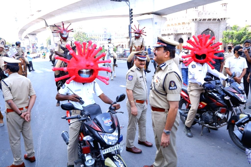 Hyderabad: Hyderabad Police Commissioner Anjani Kumar distributes 'Corona Helmets' among police personnel in Hyderabad on Day 7 of the 21-day nationwide lockdown imposed as a precautionary measure to contain the spread of coronavirus, in Hyderabad on