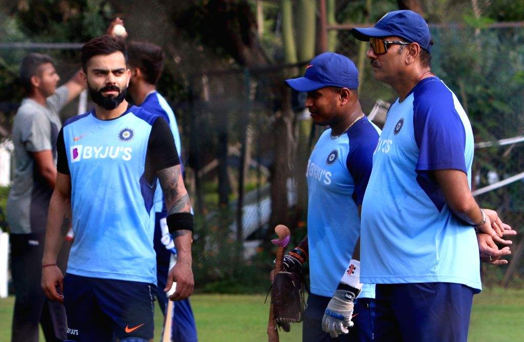 Hyderabad: India coach Ravi Shastri and skipper Virat Kohli during a practice session ahead of the first Twenty20 match against West Indies at Rajiv Gandhi International Cricket Stadium in Hyderabad on Dec 5, 2019. (Photo: Surjeet Yadav/IANS) - Virat Kohli and Surjeet Yadav