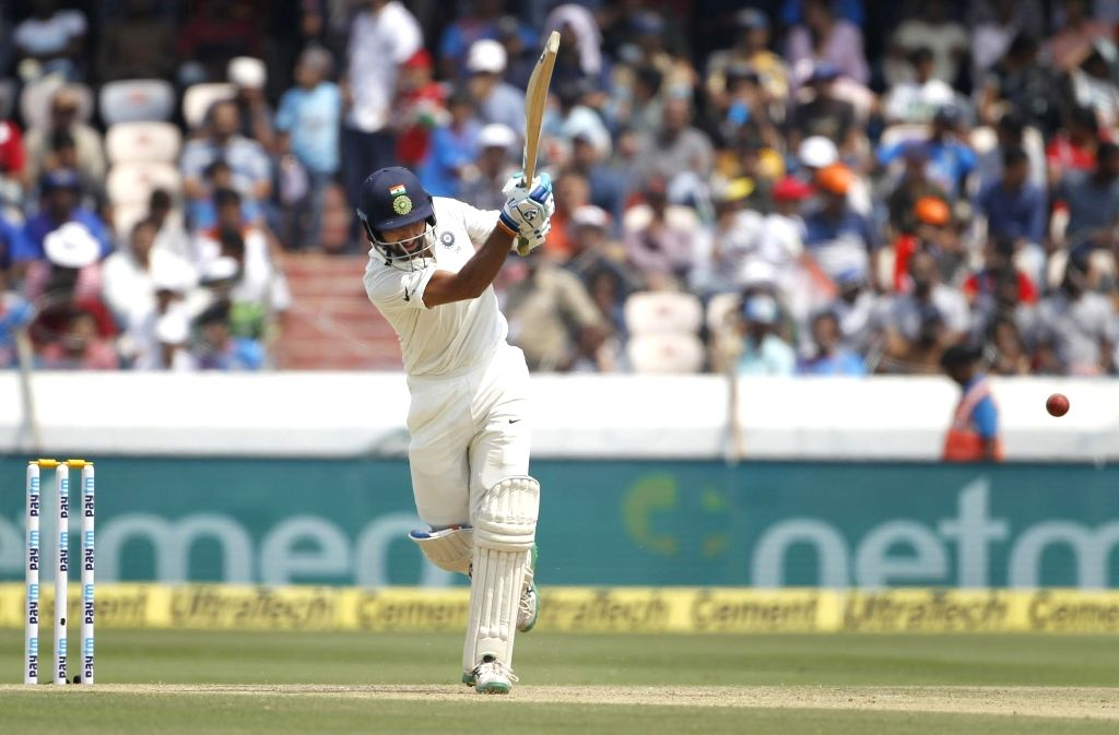 : Hyderabad: India's Cheteshwar Pujara in action on Day 2 of the Second Test match between India and West Indies at Rajiv Gandhi International Stadium in Hyderabad on Oct 13, 2018. (Photo: ...