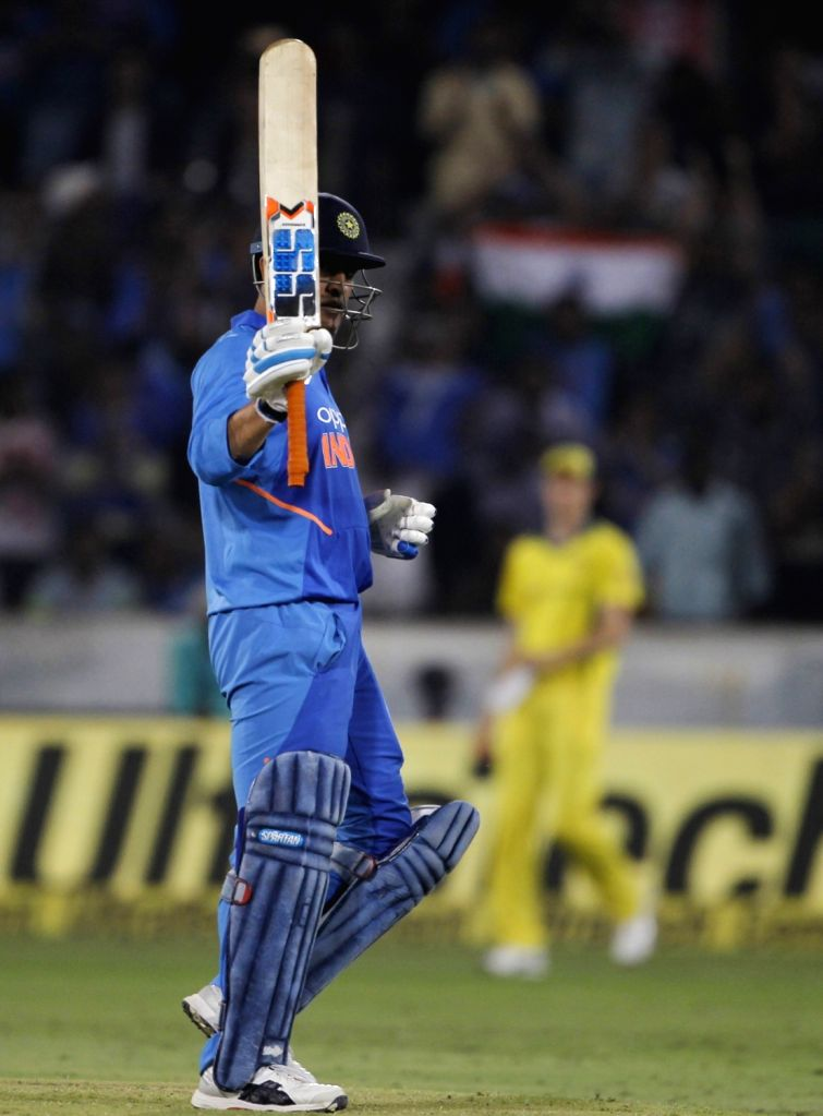 Hyderabad: India's MS Dhoni celebrates his half century during the first ODI match between India and Australia at Rajiv Gandhi International Stadium in Hyderabad on March 2, 2019. (Photo: Surjeet Yadav/IANS) - MS Dhoni and Surjeet Yadav