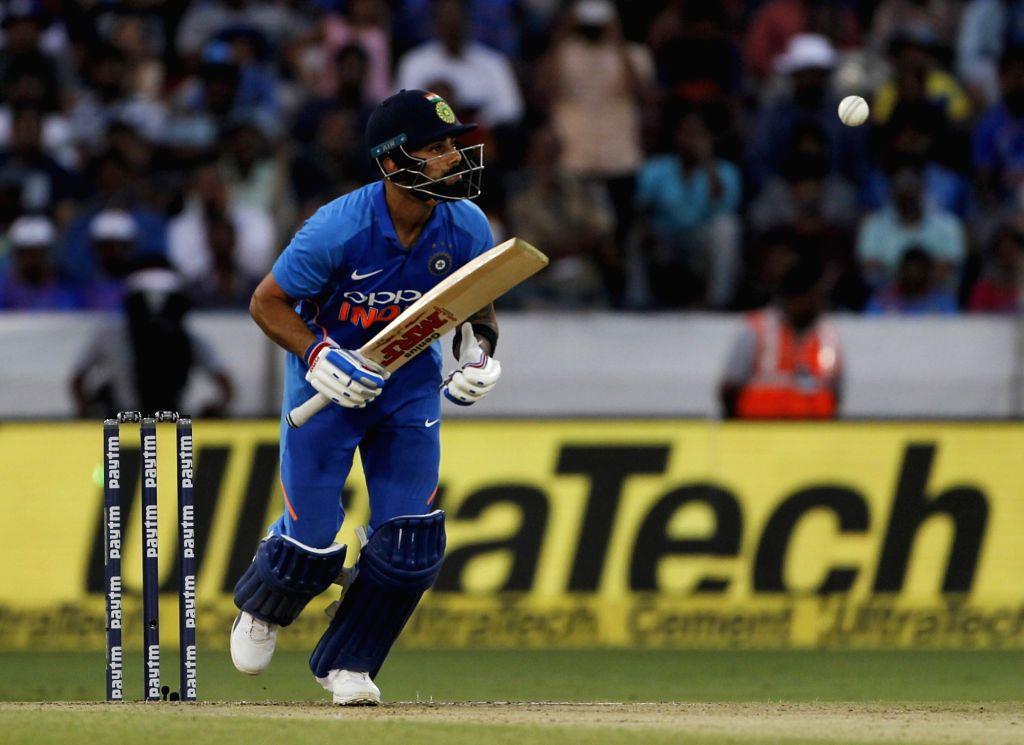 Hyderabad: India's Virat Kohli in action during the first ODI match between India and Australia at Rajiv Gandhi International Stadium in Hyderabad on March 2, 2019. (Photo: Surjeet Yadav/IANS) - Virat Kohli and Surjeet Yadav