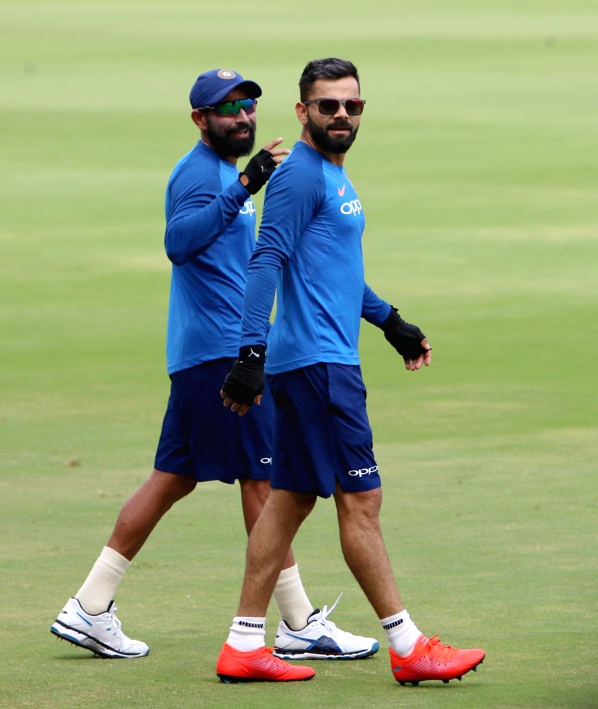 Hyderabad: Indian captain Virat Kohli with Mohammed Shami during a practice session ahead of the first ODI match against Australia at Rajiv Gandhi International Stadium in Hyderabad on March 1, 2019. (Photo: Surjeet Yadav/IANS) - Virat Kohli and Surjeet Yadav