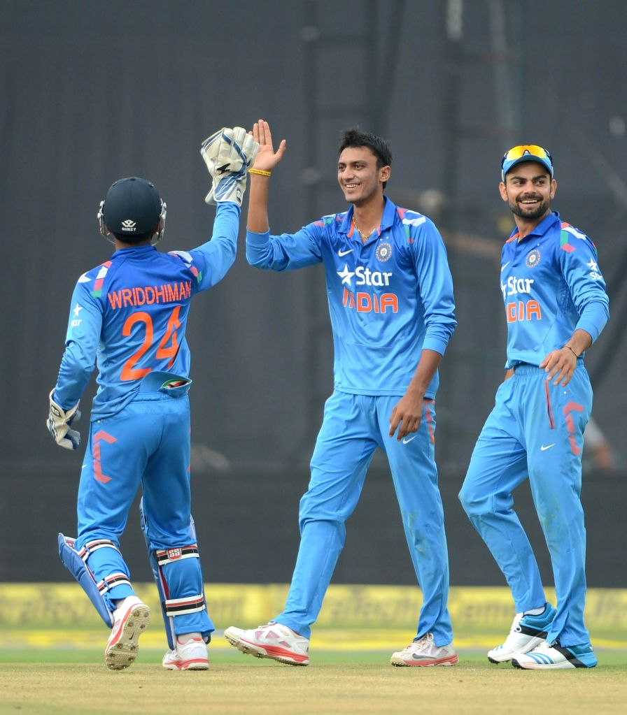 Indian players celebrate fall of a wicket during the 3rd ODI match between India and Sri Lanka at Rajiv Gandhi International Stadium in Hyderabad on Nov 9, 2014.