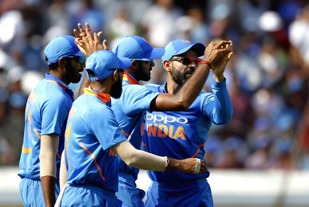 Hyderabad: Indian players celebrate fall of Usman Khawaja's wicket during the first ODI match between India and Australia at Rajiv Gandhi International Stadium in Hyderabad on March 2, 2019. (Photo: Surjeet Yadav/IANS) - Surjeet Yadav