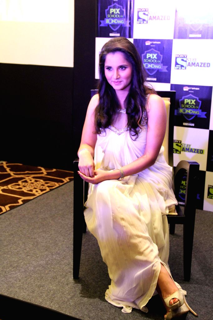 Indian tennis player ​​ Sania Mirza on the sets of `Pix school of B ​ond ing` in Hyderabad on Nov. 21, 2014.