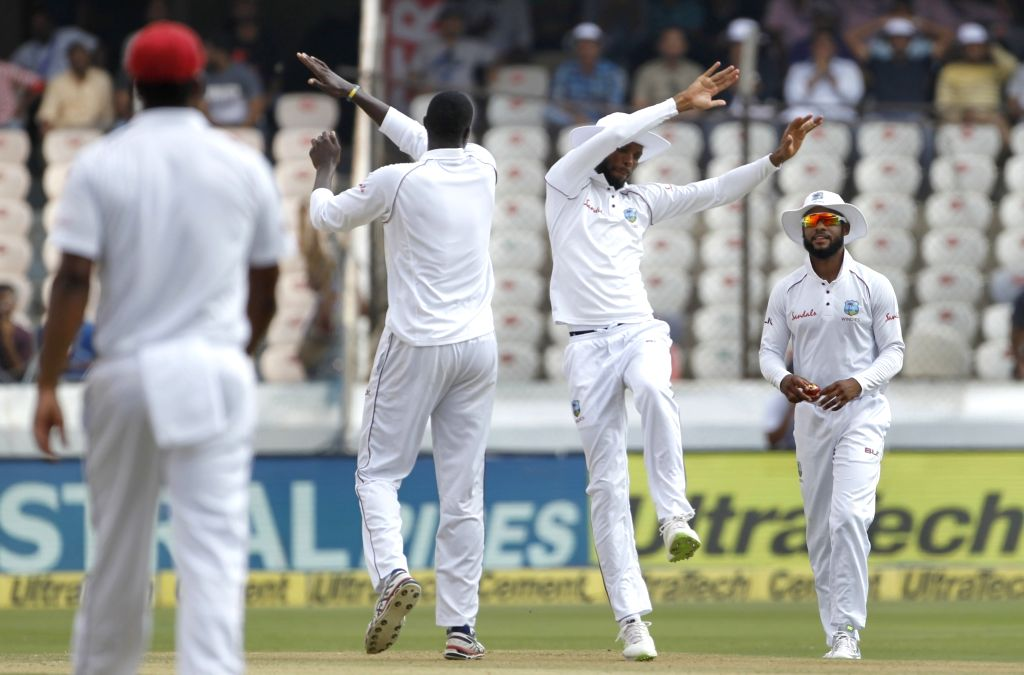 Hyderabad: Jason Holder of West Indies celebrates the fall of Ravindra Jadeja's wicket on Day 3 of the Second Test match between India and West Indies at Rajiv Gandhi International Stadium in Hyderabad on Oct 14, 2018. (Photo: Surjeet Yadav/IANS) - Ravindra Jadeja and Surjeet Yadav