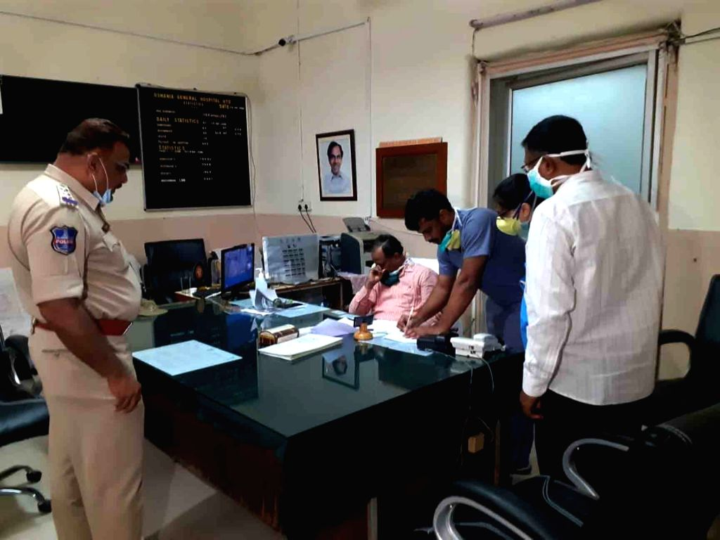 Hyderabad: Junior doctors hold an emergency meeting with Osmania General Hospital Superintendent Dr B Nagender in the presence of police personel after a Post Graduate doctor of the hospital was allegedly attacked by the relative of a susupected coro