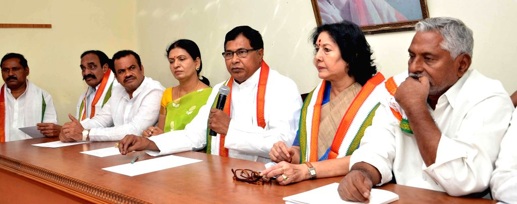 Leader of Opposition in the Telangana Assembly K. Jana Reddy and other Congress leaders addresses press after Telangana Finance Minister Etela Rajendar tabled budget in the state assembly, - Etela Rajendar