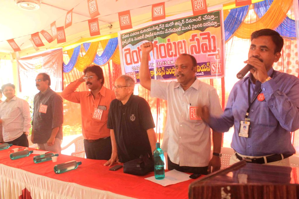 LIC employees stage a demonstration to press for their various demands in Hyderabad on Feb. 23, 2015.