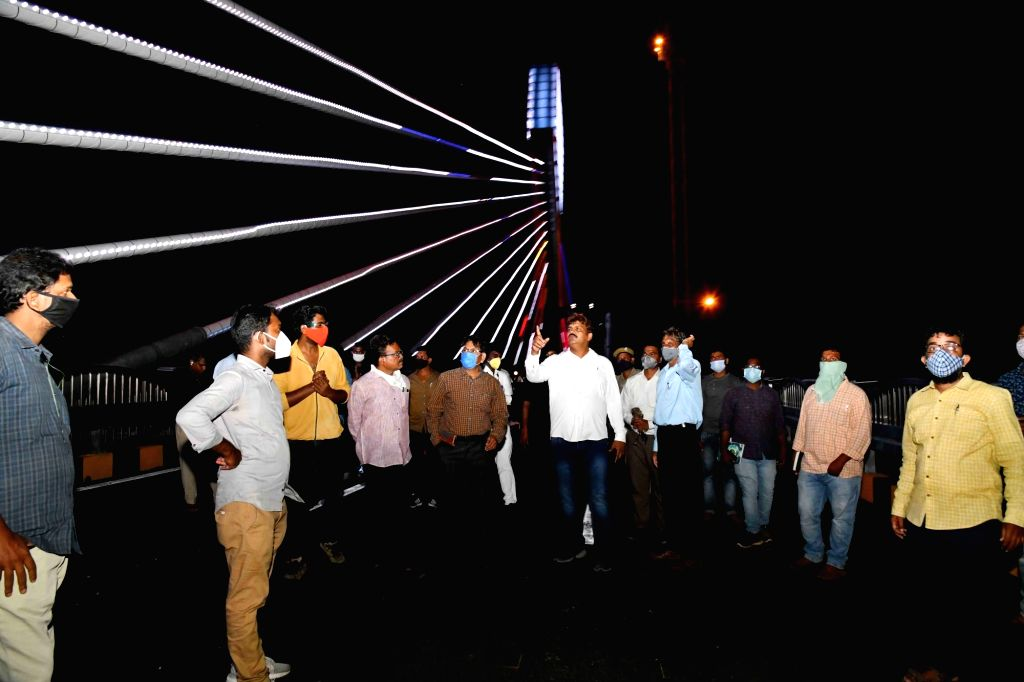 Hyderabad Mayor B. Ram Mohan inspects the cable stay bridge at Durgam Cheruvu ahead of its inauguration, in Hyderabad on Aug 13, 2020. The much awaited bridge is all set to dazzle with its ...