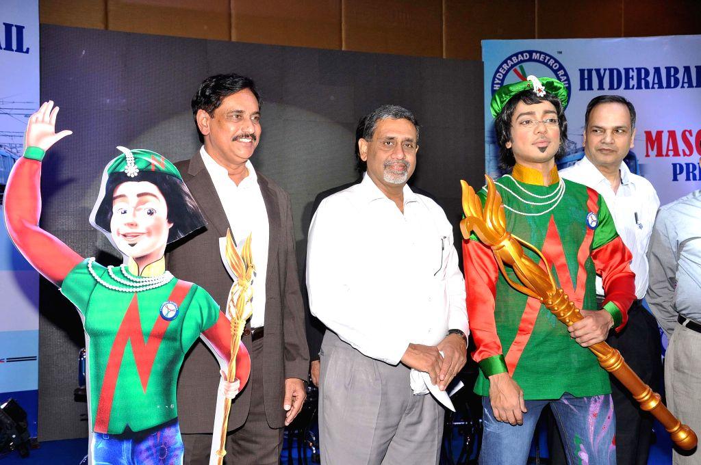 Hyderabad Metro Rail Ltd MD NVS Reddy, Telangana Chief Secretary Dr. Rajeev Sharma, Principal Secretary of Telangana Municipal Administration Urban Development Dr. S.K.Joshi at the launch the mascot . - Rajeev Sharma