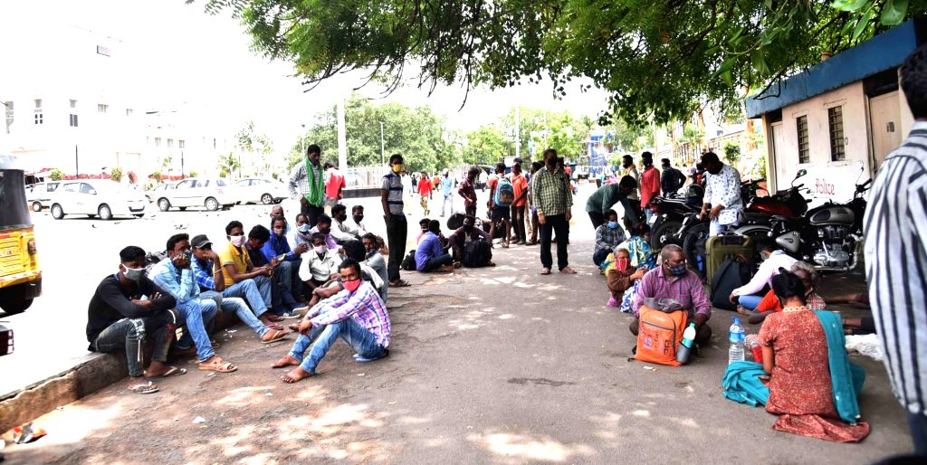 Hyderabad : Migrant people every day seating in front of Secunderabad  Railway station for Train in Hyderabad on Sunday, 13 June, 2021.