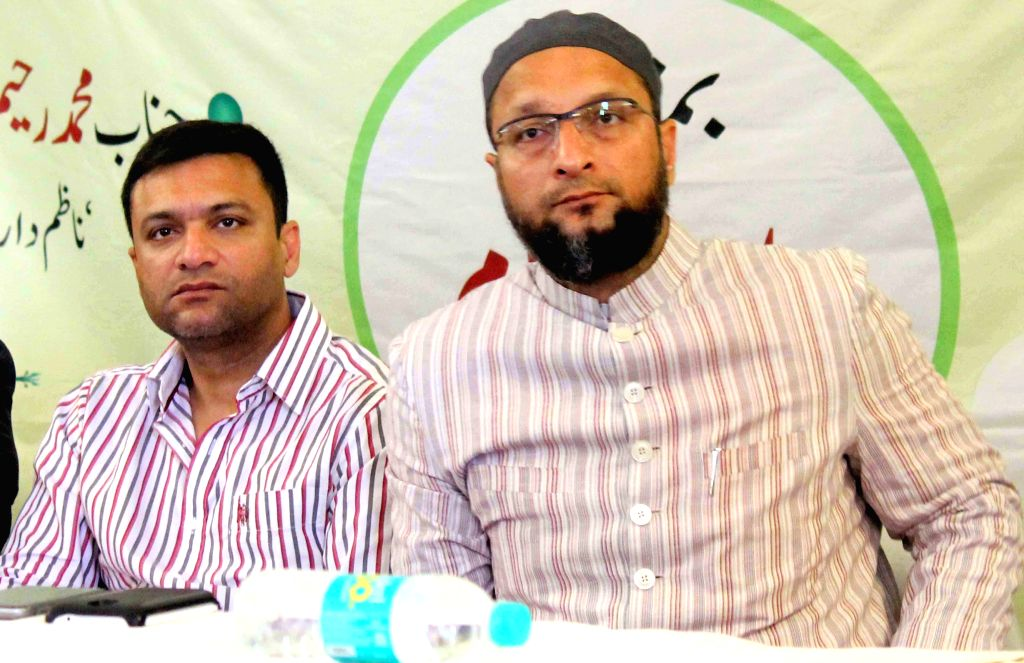 MIM chief Asaduddin Owaisi and MIM leader Akbaruddin Owaisi during a programme organised in Hyderabad on June 6, 2015.
