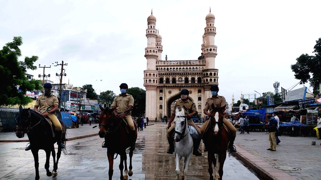 Hyderabad mounted police keeps a vigil as they patrol around the Mecca Masjid and the adjoining areas to avoid any untoward incident post Friday prayers in the wake of Bengaluru violence where an ...
