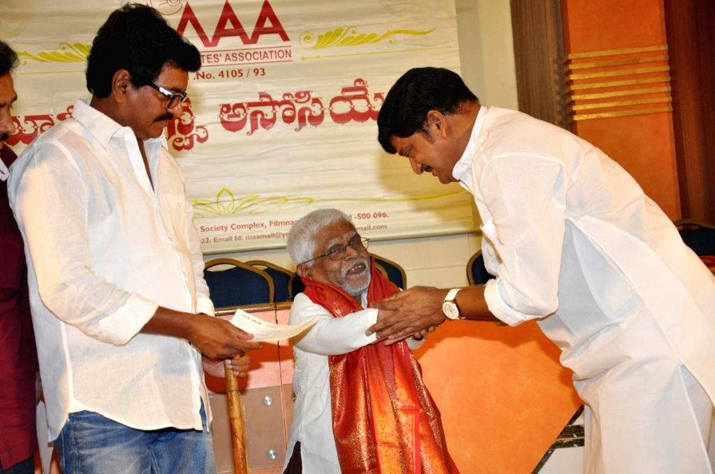 *Movie Artists Association (MAA) president Rajaendra  Prasada  presentnig  cheques  to veteran actors on the occasion of May day at  Film Chamber in Hyderabad on Friday*.