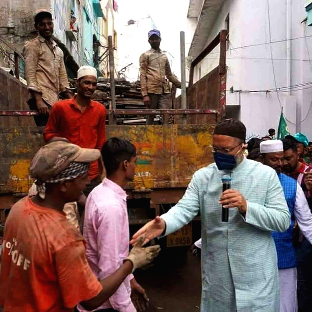 Hyderabad MP and AIMIM President Asaduddin Owaisi during the door-to-door campaign for the GHMC elections, in Hyderabad on Nov 26, 2020.