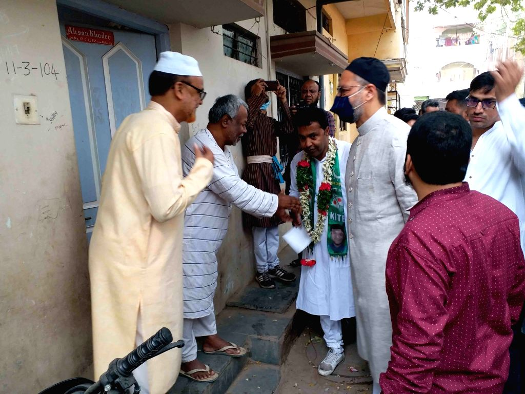 Hyderabad MP and AIMIM President Asaduddin Owaisi during the door-to-door campaign for the GHMC elections, at Mallepally and Caravan constituencies in Hyderabad on Nov 27, 2020.