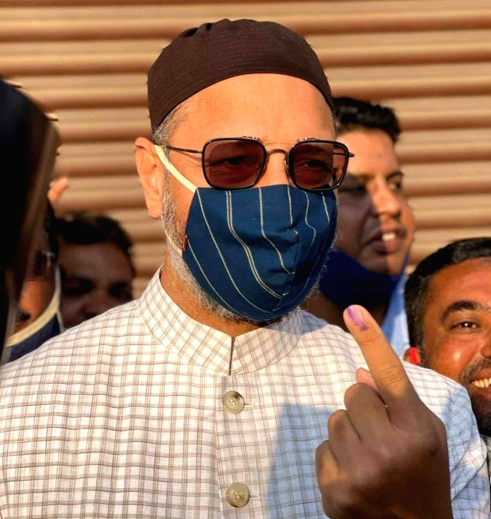 Hyderabad MP and AIMIM President Asaduddin Owaisi shows his inked finger after casting his vote for Greater Hyderabad Municipal Corporation (GHMC) elections, on Dec 1, 2020.