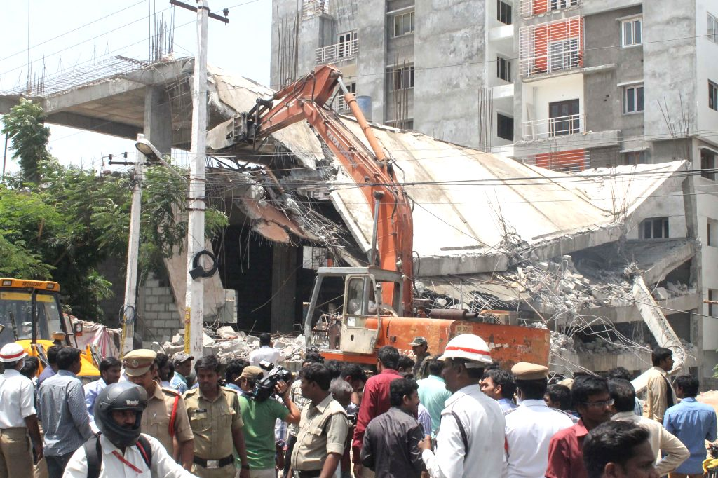 Hyderabad Municipal Corporation demolishes alleged illegal buildings on the land belonging to Gurukul Trust at Madhapur in Hyderabad  on June 24, 2014.
