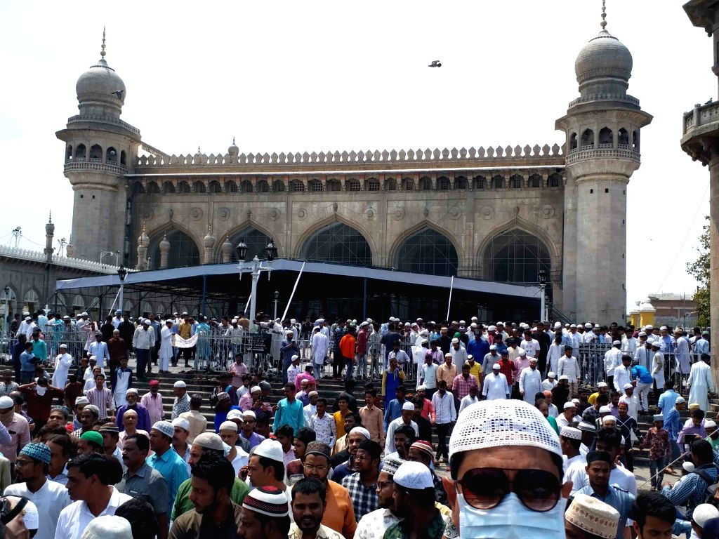 Hyderabad: Muslim devotees arrive to offer Friday prayers at Mecca Masjid amid COVID-19 (coronavirus) pandemic, in Hyderabad on March 20, 2020. (Photo: IANS)
