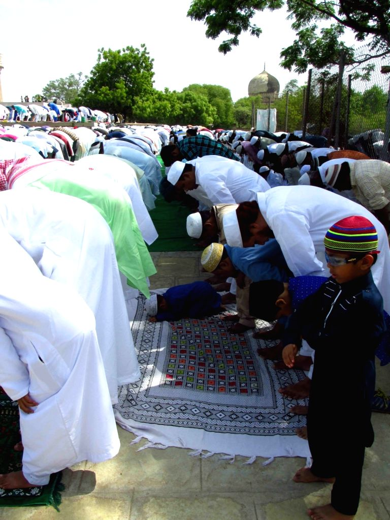 Hyderabad: Muslims offering prayer on the occasion of Eid-ul-Fitr at the historic Golconda tombs in Hyderabad on June 16, 2018. (Photo: IANS)