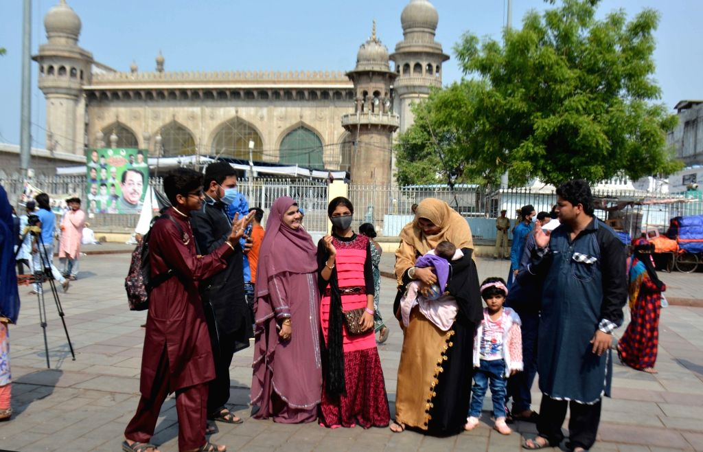Hyderabad : Muslims People exchange of greetings near Charminar macca masjed background Hyderabad police commissioner Anjani kumar greeted at Charminar in Hyderabad 14 May 2021.