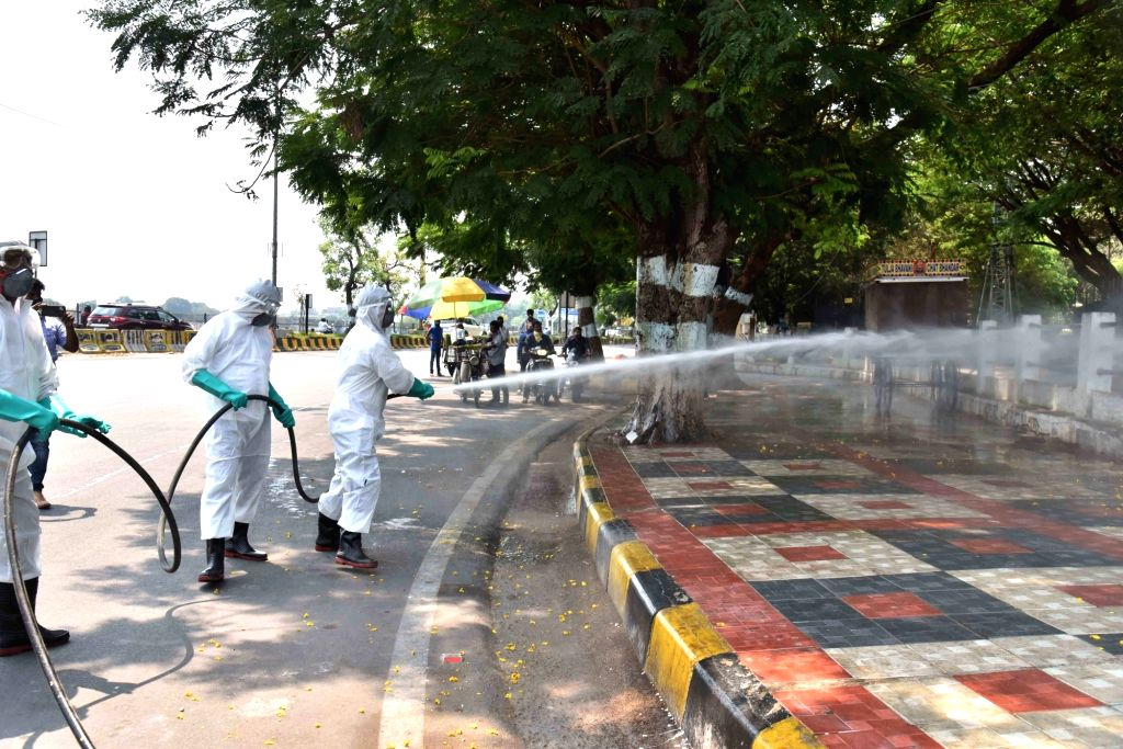Hyderabad : National Disaster Enforcement Force man sanitation and Disinfection to unprecedented surge in Covid-19 cases at NTR Marg Necklace Road  on Hyderabad 18th April.