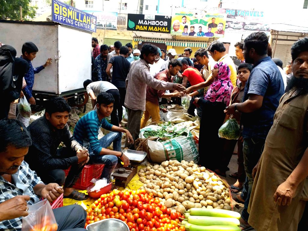 Hyderabad: People busy buying vegetables at a market during complete lockdown in the country in a bid to curtail the spread of coronavirus, in Hyderabad o March 23, 2020. (Phto: IANS)