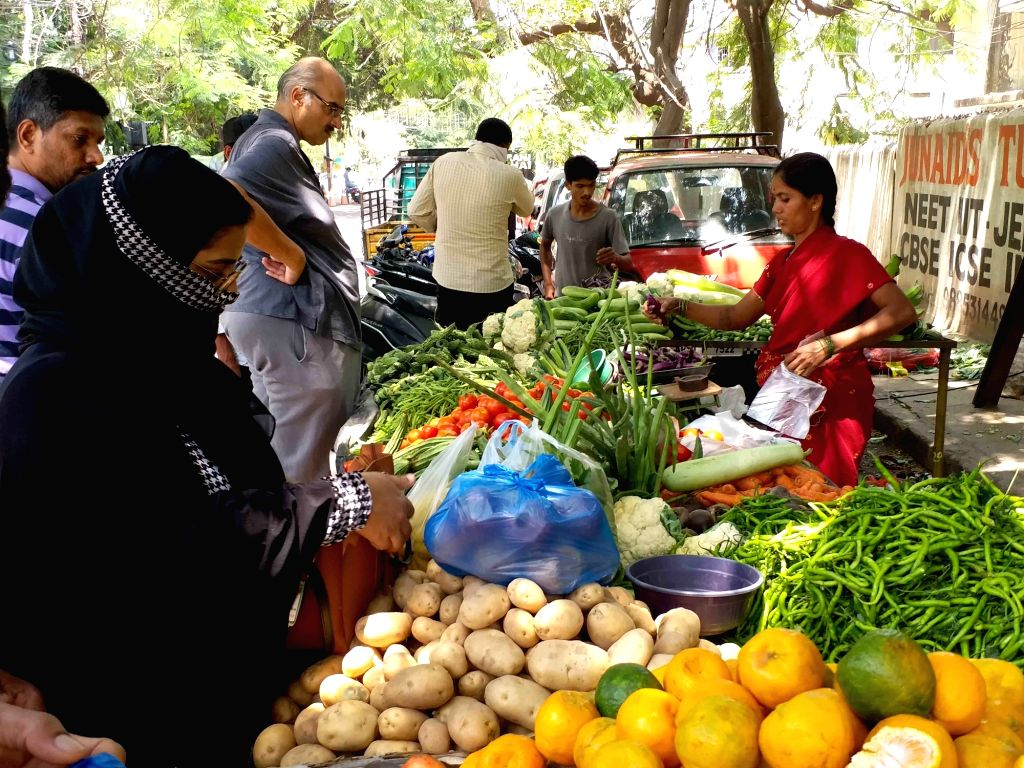 Hyderabad: People busy buying vegetables at a street-side green grocery store on the eve of 'Janata Curfew' in Hyderabad on March 21, 2020. (Photo: IANS)