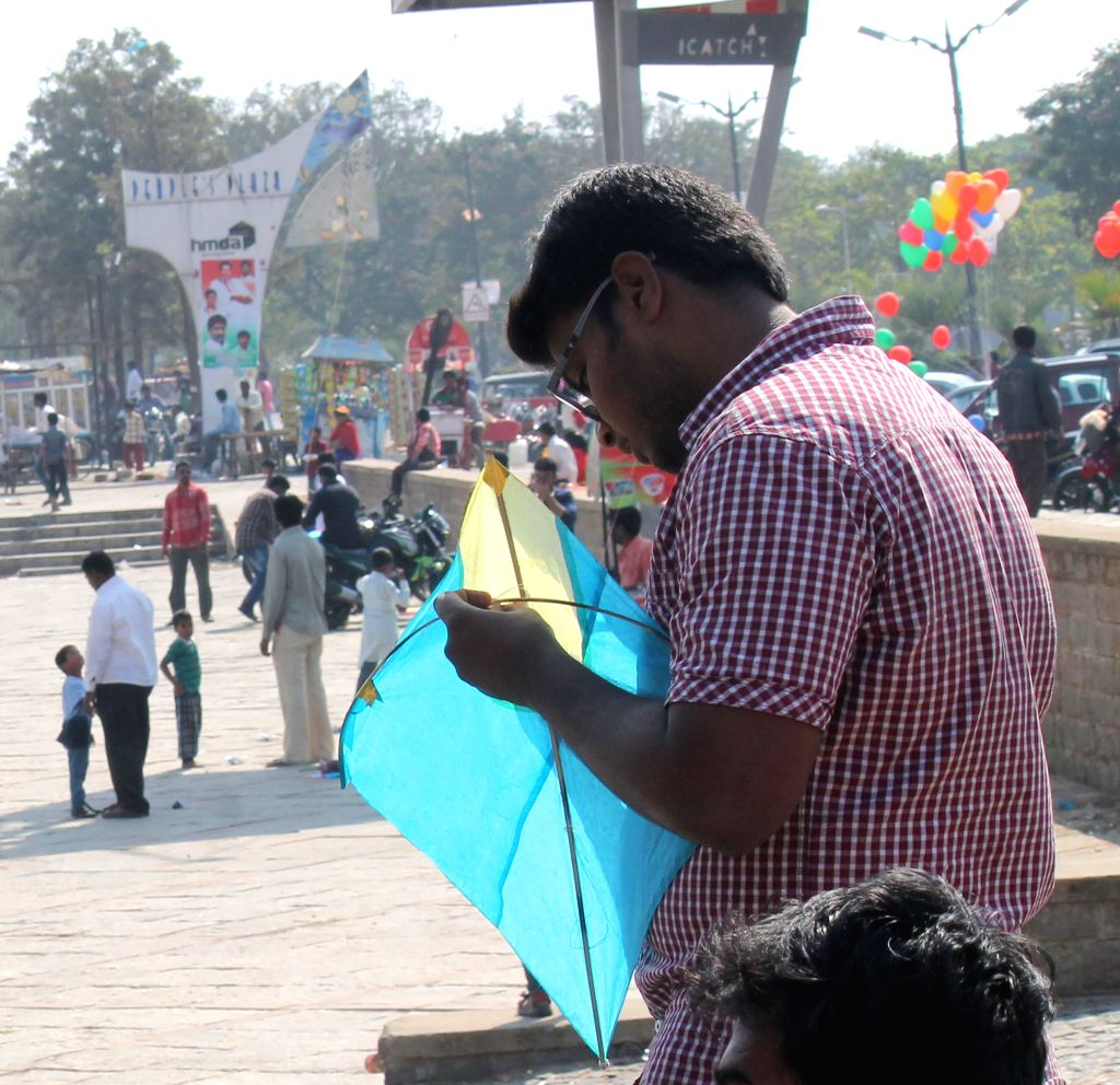 People fly kites on Makar Sankranti in Hyderabad on Jan. 14, 2015.