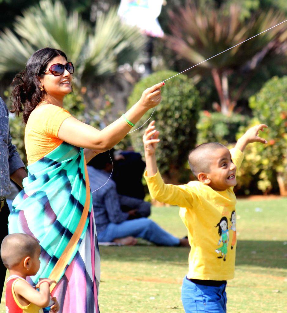 People fly kites on Makar Sankranti in Hyderabad on Jan. 14, 2015.