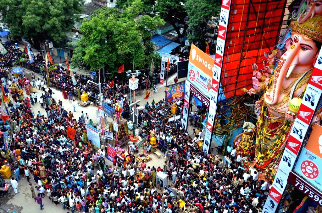 Hyderabad: People offer prayers to Lord Ganesh to a 61-feet high idol of lord Ganesh at at Khairatabad on Ganesh Chaturthi in Hyderabad on Sep 8, 2019. (Photo: IANS)