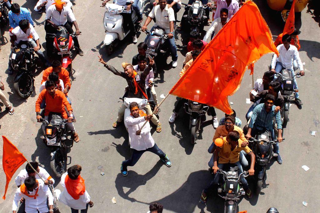 People participate in a procession organised on Hanuman Jayanti `Shobha Yatra` starting from Ram Mandir in Gowliguda to Hanuman Temple in Tadbun at Hyderabad, on April 4, 2015.