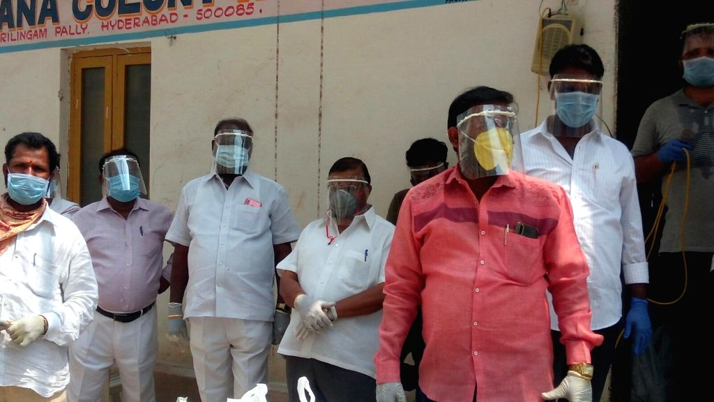Hyderabad: People wearing masks, face sheilds and gloves distribute free meals among poor, needy and homeless people in Hyderabad amid the extended nationwide lockdown imposed to mitigate the spread of coronavirus, on Apr 17, 2020. (Photo: IANS)