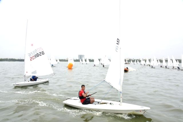 Hyderabad: Player participate during the multi class sailing championship at sailing annexe in Hussain Sagar lake; in Hyderabad on June 28, 2016.