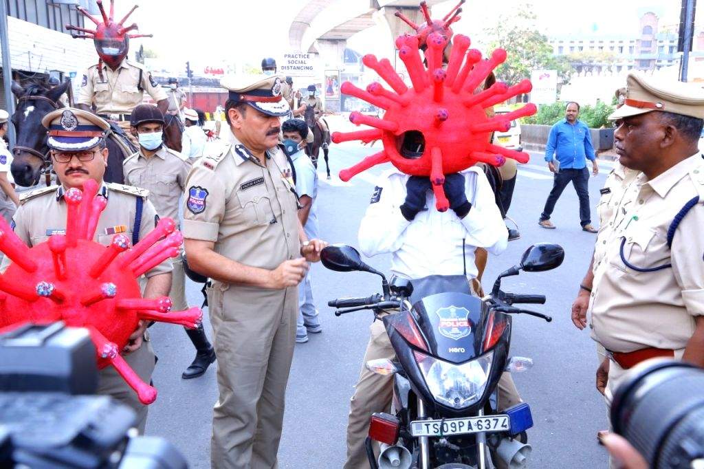 Hyderabad Police Commissioner Anjani Kumar distributes 'Corona Helmets' among police personnel in Hyderabad on Day 7 of the 21-day nationwide lockdown imposed as a precautionary measure to ...