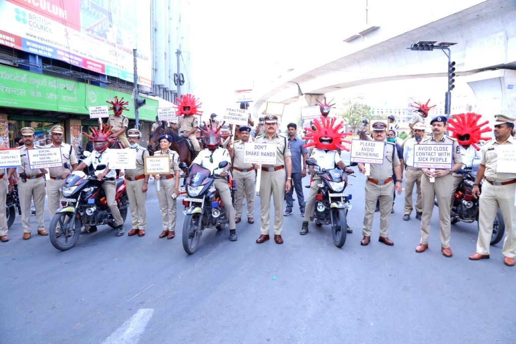 Hyderabad Police Commissioner Anjani Kumar launches a campaign to spread awareness about the do's and don'ts during coronavirus pandemic after distributing 'Corona Helmets' among police ...
