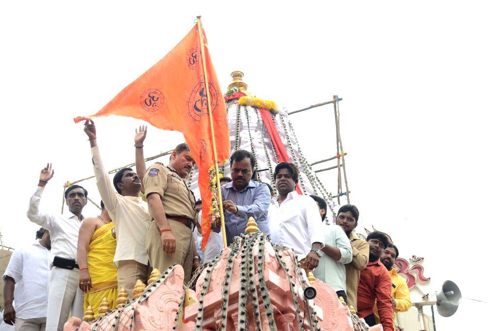 Hyderabad police commissioner Anjani Kumar and GHMC Commissioner Dana Kishore perform 'Kalash Pooja' during Bonalu festival celebrations at Lal Darwaza Temple in Hyderabad on July 19, 2019. - Anjani Kumar